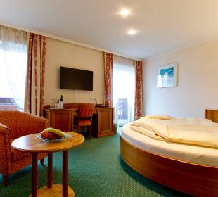 Seeblickzimmer mit rundem Bett Seeböckenhotel Zum weissen Hirschen