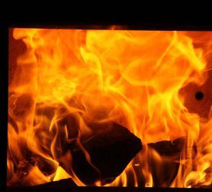 Wohliges Kaminfeuer im Wohnzimmer Ferienwohnung Haus Rosenrot