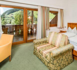 Helle und lichtdurchflutete Zimmer Naturpark Hotel Stefaner