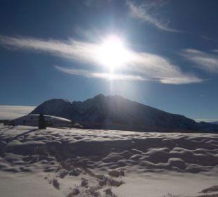 Bei einer Schneeschuhwanderung am frühen Morgen Ferienhaus Kirchplatzl