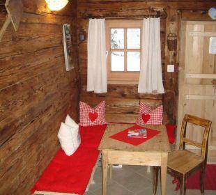 Ruheraum mit Sitzecke Wörglerhof Alpbacher Hüttenappartements & Saunaalm