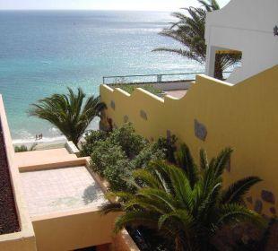 Blick aufs Meer seitlich vom Haus Hotel Rocamar Beach