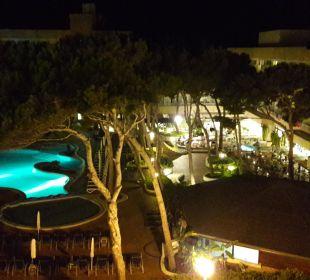 Pool bei Nacht  Hotel & Spa S'Entrador Playa