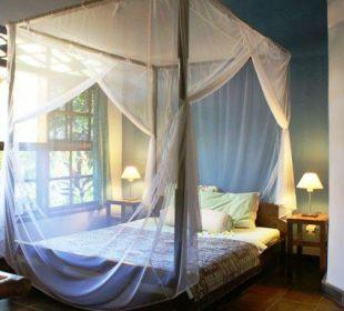 Ein Zimmer des 2-Zimmer-Bungalows Saraswati Holiday House