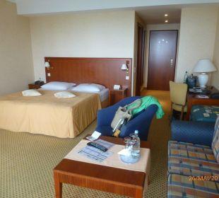 Sitzgruppe und Bett Grand Hotel Binz by Private Palace Hotels & Resorts