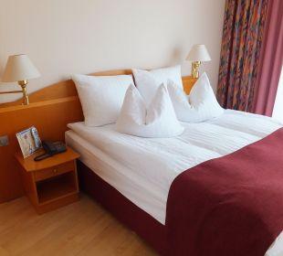 Schlafzimmer der Turmsuite Hotel Meerane