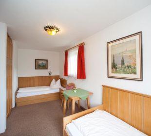 Schlafzimmer in Ferienwohnungen Padua und Ketteman Gästehaus Hotel Garni Zibert