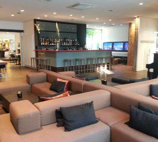 Bar mit Sitzgelegenheiten art & business hotel