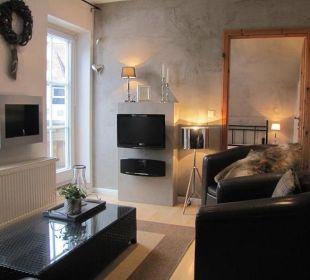 Wohnzimmer mit Gelkamin Country-Suites Landhaus Dobrick Am Schultalbach