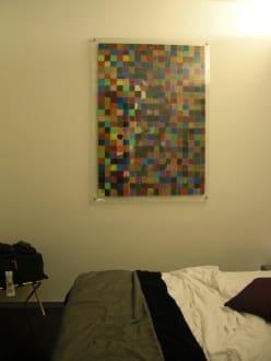 Bild an der Wand neben dem Bett - Hotel Ariston