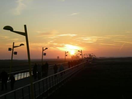 Seebrücke St. Peter Ording bei Sonnenuntergang - Gosch Sylt