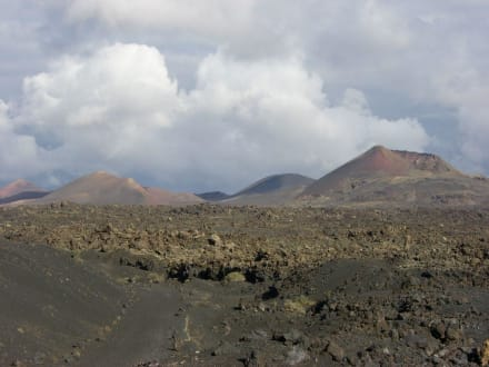 Vulkanlandschaft -  Ausflug in Nationalpark - Nationalpark Timanfaya (Feuerberge)