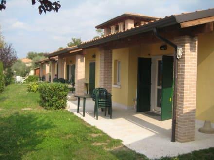 Bungalow bild ferienanlage residence piani di clodia in for Piani di bungalow di 1500 m