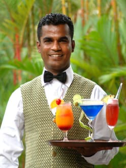 Bar Man ready with variety of cocktails -
