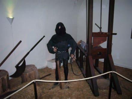 Scharfrichter an Guillotine - Foltermuseum